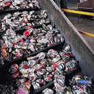 Recycling conveyor belt application shot moving soda pop cans