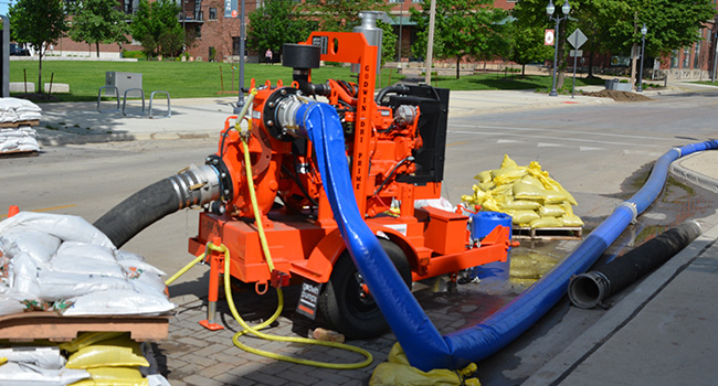 Pump with suction and discharge hoses